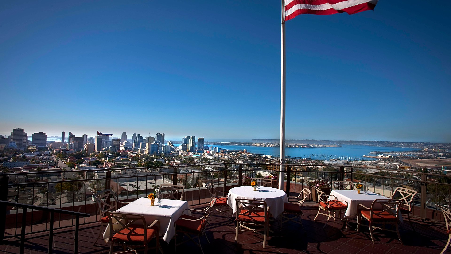 Mister A's patio with the american flag, overlooking the city